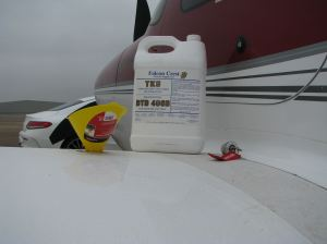 Cirrus SR22-G3 TKS filler port, funnel, and 2.5 gallon TKS fluid bottle, photo credit wikiWings