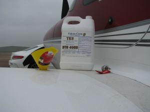 Cirrus SR22-G3 TKS filler port, funnel, and 2.5 gallon TKS fluid bottle, photo credit wikiWings